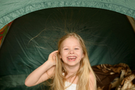 Portrait of happy girl in tent - CAVF40329