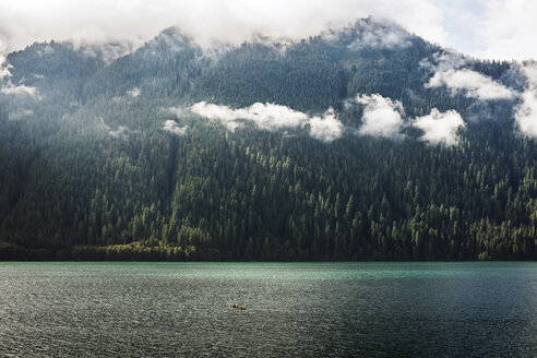 Scenic view of lake against clouds covered mountains at Mt Rainier National Park - CAVF40674