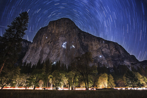 Scenic view of star trials over mountain at Yosemite National Park - CAVF40695