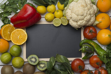 Various fruits and vegetables with vitamin c, blackboard - SKCF00423