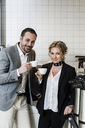 Portrait of smiling business people having coffee in kitchen - MASF04674