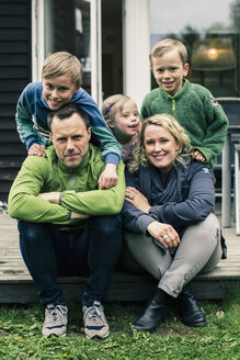 Portrait of happy family on porch - MASF04683