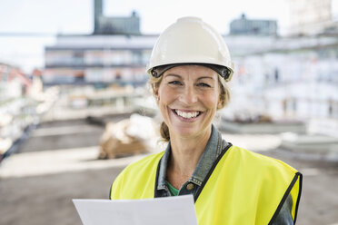 Portrait of happy female architect at construction site - MASF04692