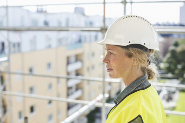Side view of female architect at construction site - MASF04758