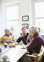 Senior people discussing at breakfast table in nursing home - MASF04764