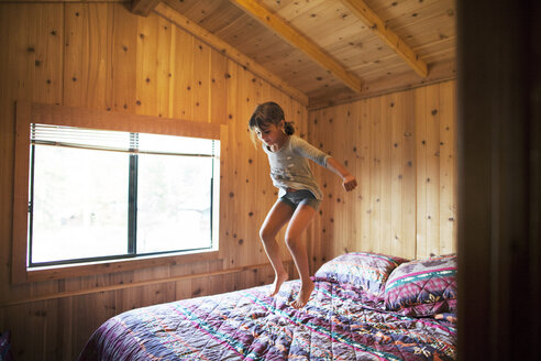 Happy girl jumping on bed - CAVF42005