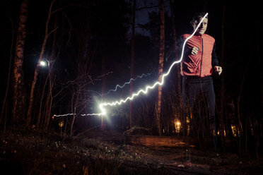 Man running with light trails in forest - MASF04901