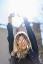 Portrait of happy young woman wearing mirrored sunglasses - AFVF00443