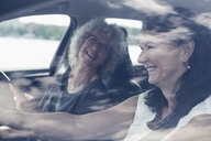 Happy senior women enjoying road trip - MASF04920