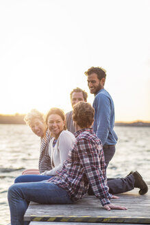 Happy friends on pier against clear sky - MASF04962