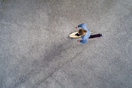 Man longboarding, top view - STSF01487