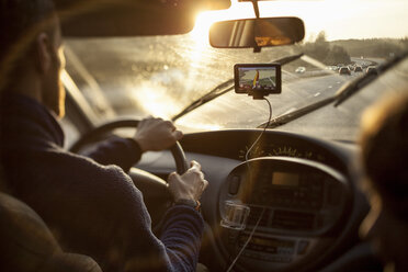 Cropped image of man driving car while using GPS by daughter - MASF05060