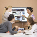 Businesswomen discussing presentation in creative office - MASF05189