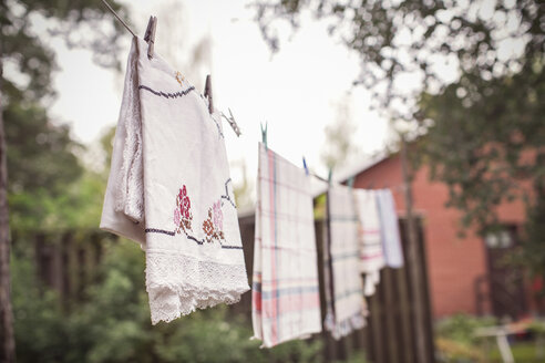 Clothes drying on string at organic farm - MASF05207