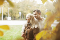 Romantic couple at park during autumn - MASF05273