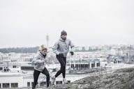 Sporty couple jogging together - MASF05397