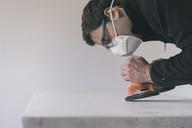 Man sanding door - SKCF00435
