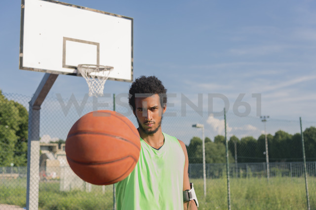 Young basketball player holding ball - FMOF00341