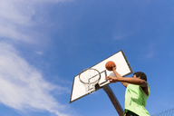 Young man playing basketball - FMOF00347