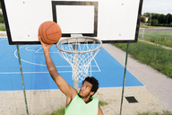 Young man playing basketball - FMOF00353
