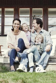 Portrait of happy family of four enjoying in yard - MASF05483