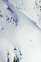 High angle view of man skiing on mountain slope - MASF05588