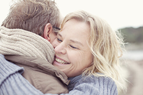 Happy woman embracing man outdoors - MASF05597