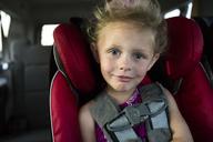 Portrait of smiling girl traveling in car - CAVF43030
