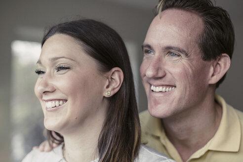 Happy couple looking away - MASF05653