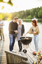 Friends enjoying barbecue party on pier - MASF05665