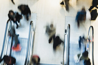 Blurred motion of people using escalator in shopping mall - MASF05695