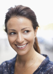 Businesswoman smiling while looking away outdoors - MASF05722