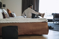 Businessman relaxing in hotel room - MASF05809