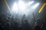 Rays of spotlights over crowded dance floor at disco - MASF06015