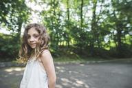 Portrait of confident girl standing at park - CAVF44203