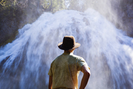 Rear view of man standing against Chush Falls - CAVF44803