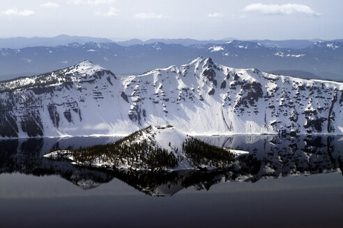 Snowcapped wizard island in crater lake - CAVF44923