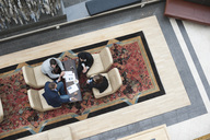 High angle view of business people having a discussion in office - MASF06283