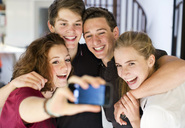 Happy young friends taking self portrait through cell phone - MASF06295
