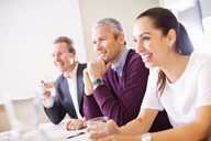 Happy business people in a meeting - MASF06379