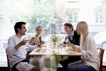 Group of happy friends at restaurant table - MASF06427