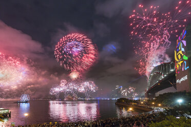 Australia, New South Wales, Sydney, Sydney Harbour Bridge and firework over city - MKF00341