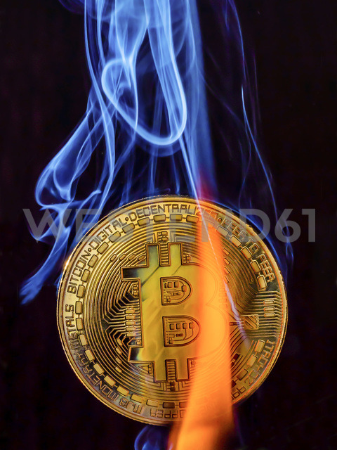 Bitcoin with flame and smoke - EJWF00865
