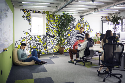 Business people working in creative office - CAVF45635