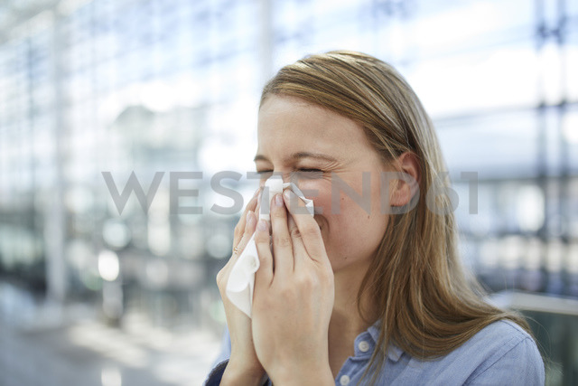 Young woman blowing nose - PNEF00612