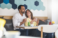 Couple in love drinking coffee in a cafe - DIGF03934