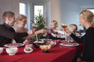 Happy family at dinner table - MASF06730