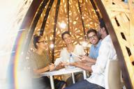 Creative business people meeting in creative workspace teepee - HOXF03382