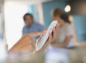 Close up businesswoman touching, using smart phone - HOXF03388