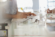 Creative businesswoman brainstorming, writing - HOXF03394